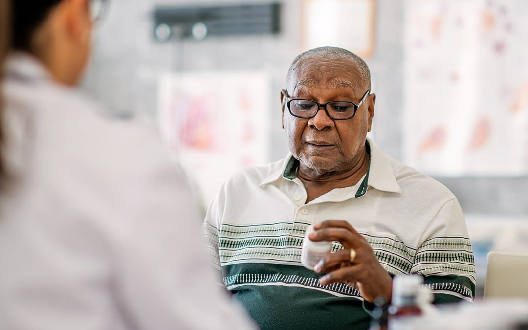 Older Man Considering Medication Adherence