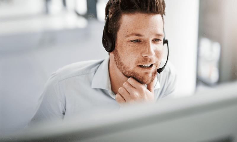 Man on phone working a telehealth job at Carenet