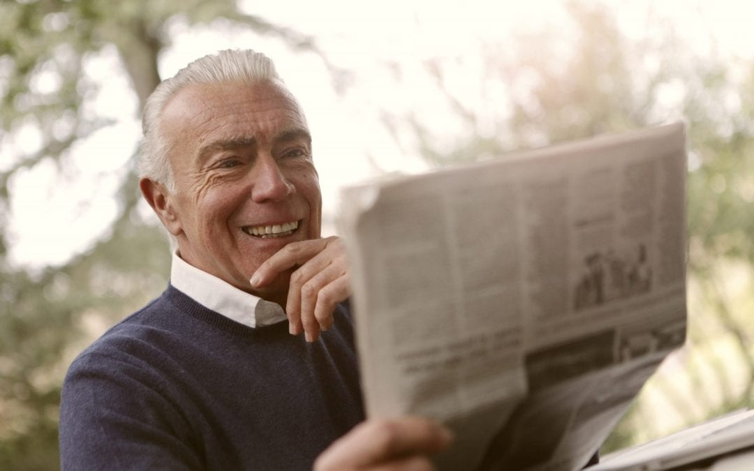 Happy Medicare Advantage senior reading the paper